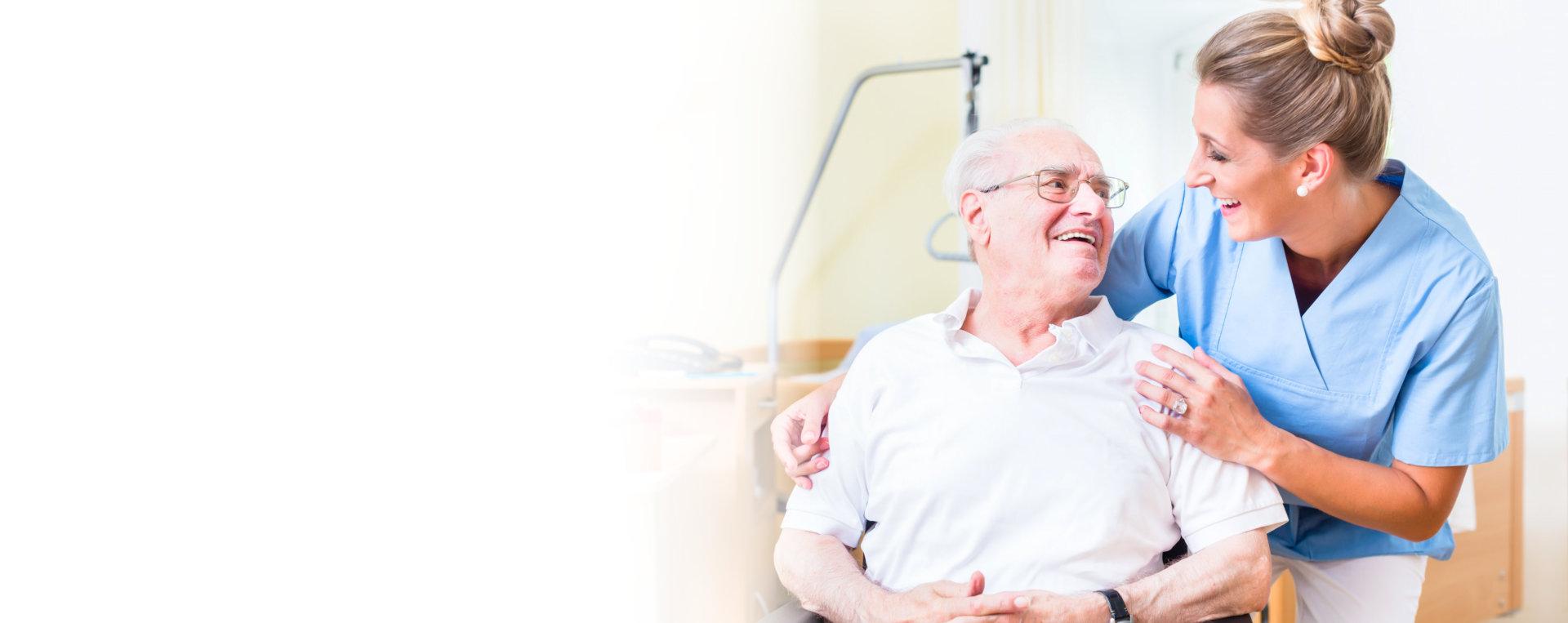 female medical staff with senior man smiling